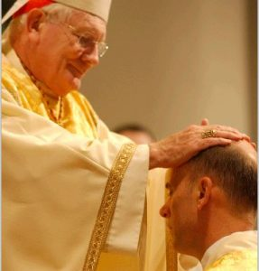 Cardinal William Keeler lays his hands on the head of Bishop Kevin C. Rhoades during the bishop's Episcopal ordination at St. Patrick Cathedral in Harrisburg on Dec. 9, 2004. Cardinal Keeler and Bishop Rhoades are both sons of Assumption of the Blessed Virgin Mary Parish in Lebanon and graduates of Lebanon Catholic High School. As a priest of the Diocese of Harrisburg, then-Father Rhoades served as Bishop Keeler's assistant Chancellor.