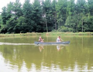 Campers enjoy the peace and serenity of canoeing.