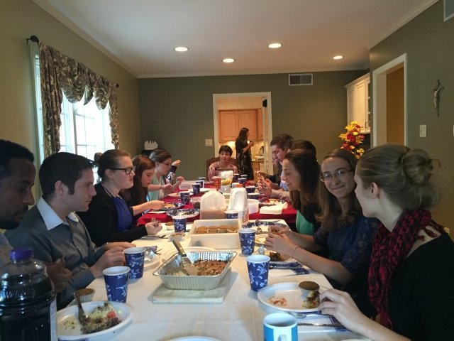 Students from Messiah College in Grantham enjoy a meal together.
