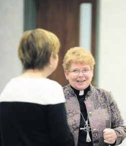 Rev. Barbara Collins, Bishop of the Upper Susquehanna Synod of the Evangelical Lutheran Church in America, engages an attendee. The Day of Dialogue included prayers of the Lutheran, Anglican and Catholic traditions.