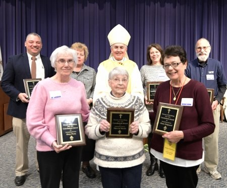 Recipients of the Catechetical Awards are congratulated by Bishop Ronald Gainer. Front row from left, Mary Pentz, Theresa Nardis and Diane Dalgaard. Back row from left are Armando Torres, Sister Rita Smith, SSJ, Bishop Gainer, Jean Marie Fischer and Joseph Ceserano.