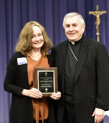Dorothy Hilton, recipient of the Catechetical Award is congratulated by Bishop Ronald Gainer.