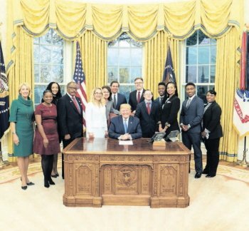 Participants of the Education Empowerment Roundtable are pictured with President Donald Trump Dec. 9. Myles Slade-Bowers is second from right.