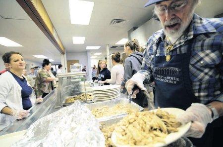 Don Mancuso serves the fresh-baked turkey.