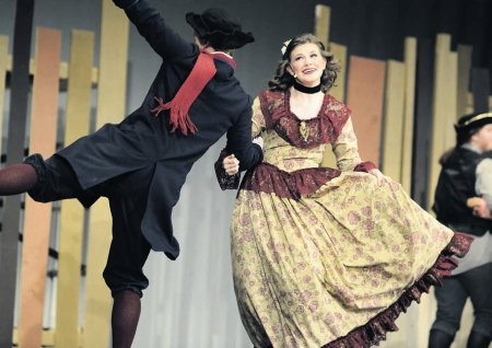 Ichabod Crane, played by James McInery, and Hannah Arnold, as Katrina Van Tassel, share a dance before Ichabod's mysterious disappearance.