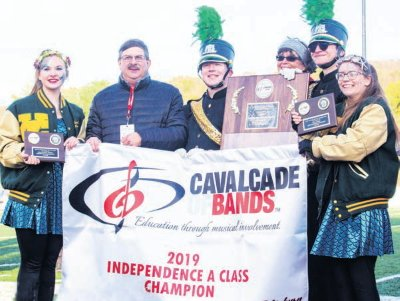 Drum majors Moses Krueger and Mason Kovach and color guard captains are Susie Konstans and Bethany Weaver display York Catholic's awards at the Cavalcade of Bands.