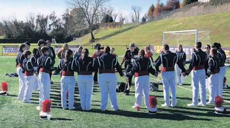 Delone Catholic marching band members form a prayer circle prior to competition.