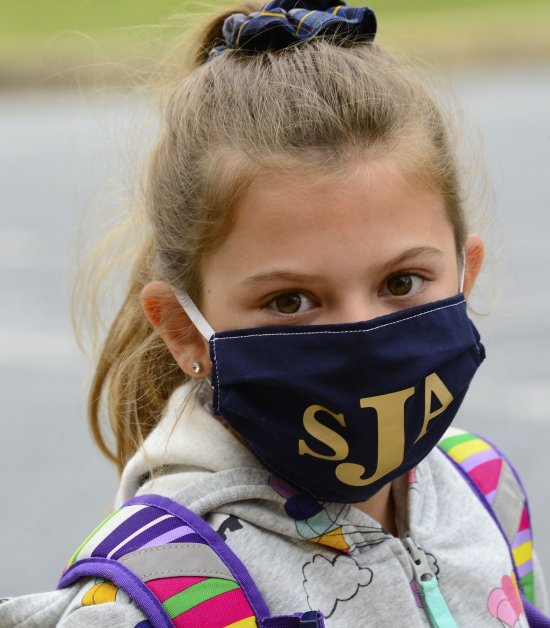 Isabel Baab proudly displays her St. Joan of Arc School mask.