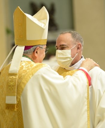 Father William Barbee receives a Sign of Peace from Bishop Ronald Gainer during the Rite of Ordination on Oct. 24.