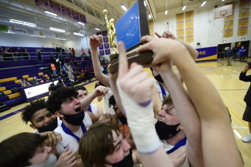 The Crusaders celebrate their repeat District 3 championship with their home crowd.