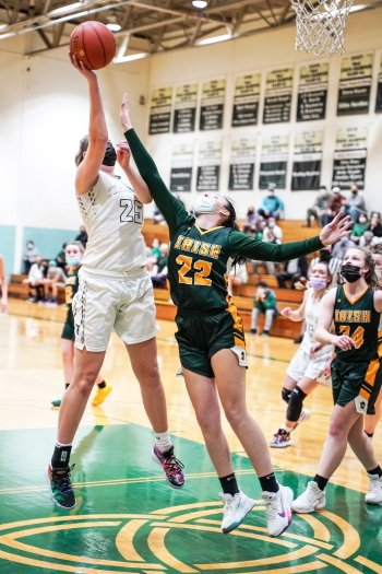 Trinity's Lauren Trumpy uses her height to score two of her 25 points.