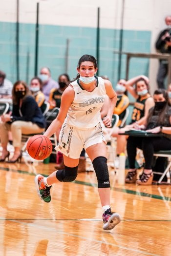 Trinity's senior sharpshooter Ava Stevenson brings up the ball. She scored her 1,000th point in February to join the ranks of past 'Rocks' greats.